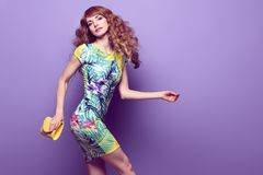 Inspired Young woman dance, fashion Wavy Hairstyle stock photography