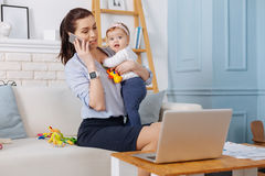 Inspiring charismatic mother calling her business partner Royalty Free Stock Images