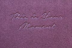 Inspiring Creative Motivation Quote Poster Template. Gold Letters. Inspirational quote `This is your moment`, letters hand writing, calligraphy style on purple Royalty Free Stock Photos