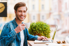 Inspiring with cup of fresh coffee. Royalty Free Stock Image