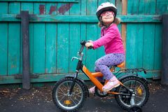 Inspiring girl on bicycle Stock Image