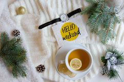 Inspiring greeting Hello Weekend winter background fir branches, cones.Flat lay. Inspiring greeting Hello Weekend winter background knitted things, fir branches Stock Photography