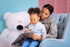 Inspiring mother helping her child write an essay Royalty Free Stock Photos