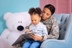 Inspiring mother helping her child write an essay