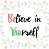 Inspiring quote 'Believe in yourself' hand painted brush lettering on the hand painted flowers backdrop.  Stock Image