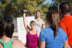 Insructor Demonstrating Kettle Bell Lifting Royalty Free Stock Images