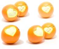 inställda hjärtaapelsiner Royaltyfri Fotografi