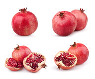 inställda saftiga pomegranates Arkivfoto
