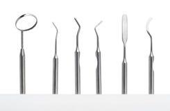 inställda tand- instrument för omsorg Royaltyfri Foto