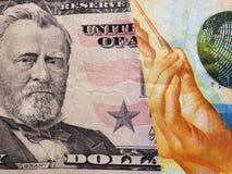 inställning till den amerikanska sedeln av femtio dollar och den schweiziska sedeln av tio franc, bakgrund och textur arkivbild