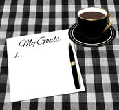 Inställningsmål papper och kopp kaffe Royaltyfria Foton