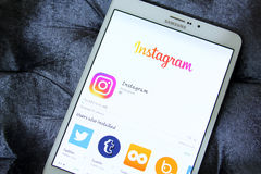 Instagram app. Downloading instagram application from google play store on samsung tab s2 stock image