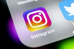 Instagram application icon on Apple iPhone X smartphone screen close-up. Instagram app icon. Social media icon. Social network. Sankt-Petersburg, Russia, August stock photo