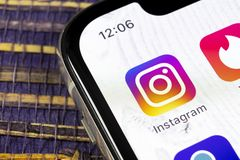 Instagram application icon on Apple iPhone X smartphone screen close-up. Instagram app icon. Social media icon. Social network. Sankt-Petersburg, Russia royalty free stock image