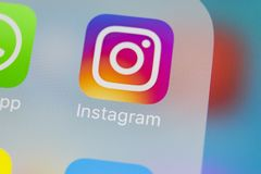 Instagram application icon on Apple iPhoneX smartphone screen close-up. Instagram app icon. Social media icon. Social network. Sankt-Petersburg, Russia, March 13 Stock Photo