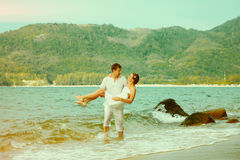 Instagram colorized vintage couple on beach portrait Stock Image