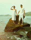 Instagram colorized vintage couple on beach portrait Royalty Free Stock Image