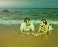 Instagram colorized vintage couple on beach portrait Royalty Free Stock Photo