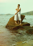 Instagram colorized vintage couple on beach portrait Royalty Free Stock Images