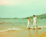 Instagram Colorized Vintage Couple On Beach Portrait Stock Photo