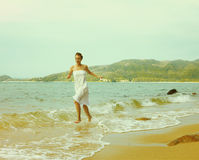 Instagram colorized vintage girl on beach portrait. Instagram colorized vintage outdoor portrait of young woman in white cotton clothes on beach of Phuket island stock photo