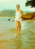 Instagram colorized vintage girl on beach portrait Royalty Free Stock Photos