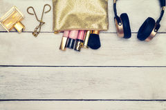 Instagram filter. Cosmetic, lip gloss in cosmothic golden color. Instagram filter. Cosmetic, lip gloss, Perfume in cosmetic bag golden color Stock Photography