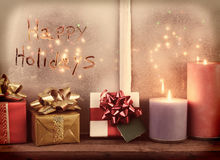 Instagram Happy Holidays Window. Happy Holidays written in the frost of a window with Christmas lights on the outside of the window. The image has an instagram royalty free stock photos