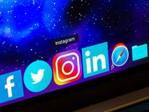 Instagram icon on dark space background on macbook screen, macro. NIZHYN, UKRAINE - November 12, 2018: Instagram icon on dark space background on macbook screen stock images