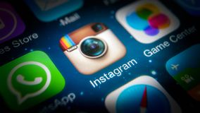 Instagram icon on mobile phone screen close-up. Moscow - March 11, 2019: Instagram logo on IPhone screen close-up. Application icon of Instagram social media on stock images