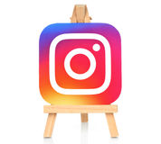 Instagram icon printed on paper and placed on wooden easel royalty free stock images
