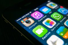 Instagram icon on smartphone screen close-up. Moscow - March 11, 2019: Instagram logo on IPhone screen close-up. Application icon of Instagram social media on royalty free stock image
