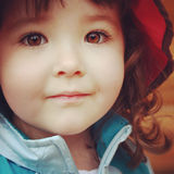 Instagram image closeup up of little girl with stunning brown ey Stock Image