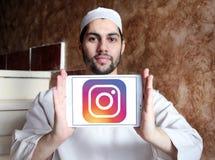 Instagram logo. Logo of instagram on samsung tablet holded by arab muslim man stock image