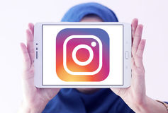 Instagram logo. Logo of instagram on samsung tablet holded by arab muslim woman stock photography