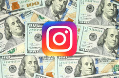 Instagram new logo printed on paper and placed on money background Royalty Free Stock Photos