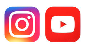Instagram new logo and Youtube icon printed on white paper. Kiev, Ukraine- July 25, 2016: Instagram new logo and Youtube icon printed on white paper