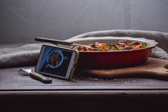 Instagram photography blogging workshop concept. phone near a stylish plate with grilled vegatables on wooden rustic background. Copy space royalty free stock image