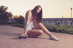 Instagram style image of cute girl sitting on her Royalty Free Stock Photos