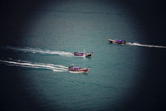 Instagram Sutro Filter Effect picture of three motorboats Stock Photo