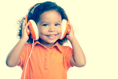 Instagram toned small girl listening to music Stock Photos