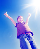 Instagram of Young Girl with Arms Raised Towards Sunshine Royalty Free Stock Photos