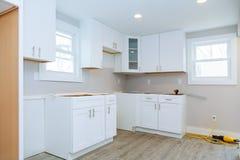 Instal kitchen cabinets Interior design construction of a kitchen. Interior design construction of a kitchen with instal kitchen cabinets stock photo