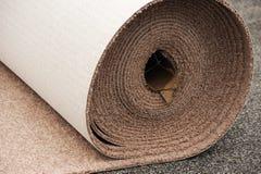 Instalación de la alfombra Fotografía de archivo libre de regalías