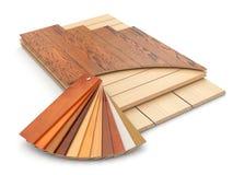 Instalación del piso laminado y de las muestras de madera. Imagen de archivo libre de regalías