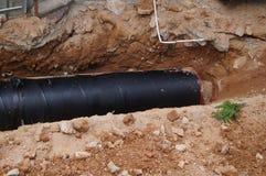 Instalación subterráneo del tubo Imagen de archivo