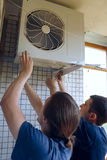 Install air conditioning Stock Photography