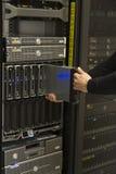 Install Blade Server. Install or remove a blade server in a blade chassis in a rack. Shot in a data center stock image
