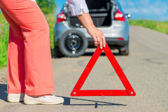 Install an emergency stop sign on the pavement. Near the machine stock photo
