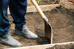 Install the formwork and remove the top layer of the ground by digging a pit or trench. Independent concreting of the. Site or track. A man in dirty shoes is Stock Images